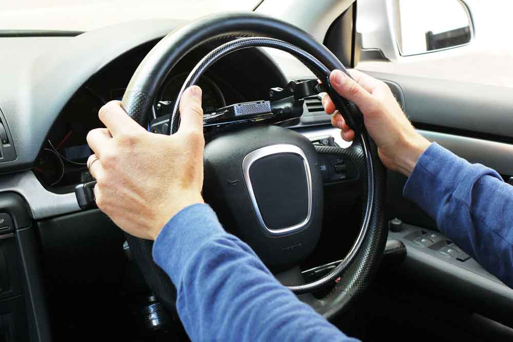 man driving with Fadiel Italiana overing accelerator hand control