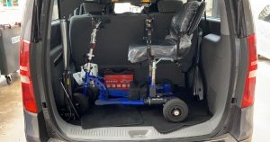 Blue scooter attached to an SG50 hoist inside an Imax boot