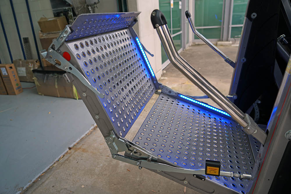 Platform lift unfolding at the back of a van - side view