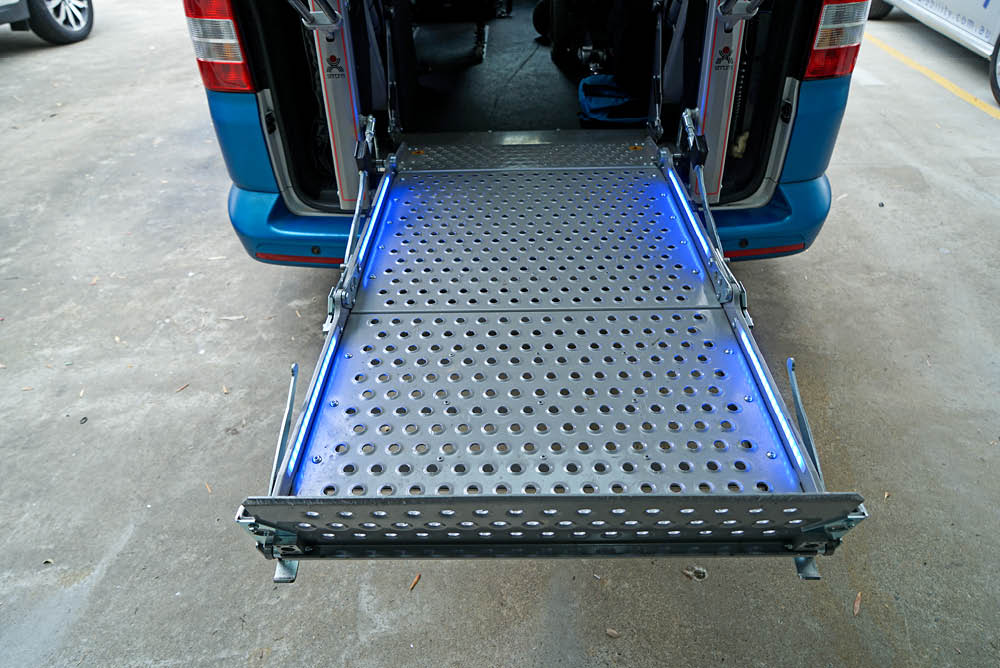 Platform lift unfolded at the back of a van - rear view