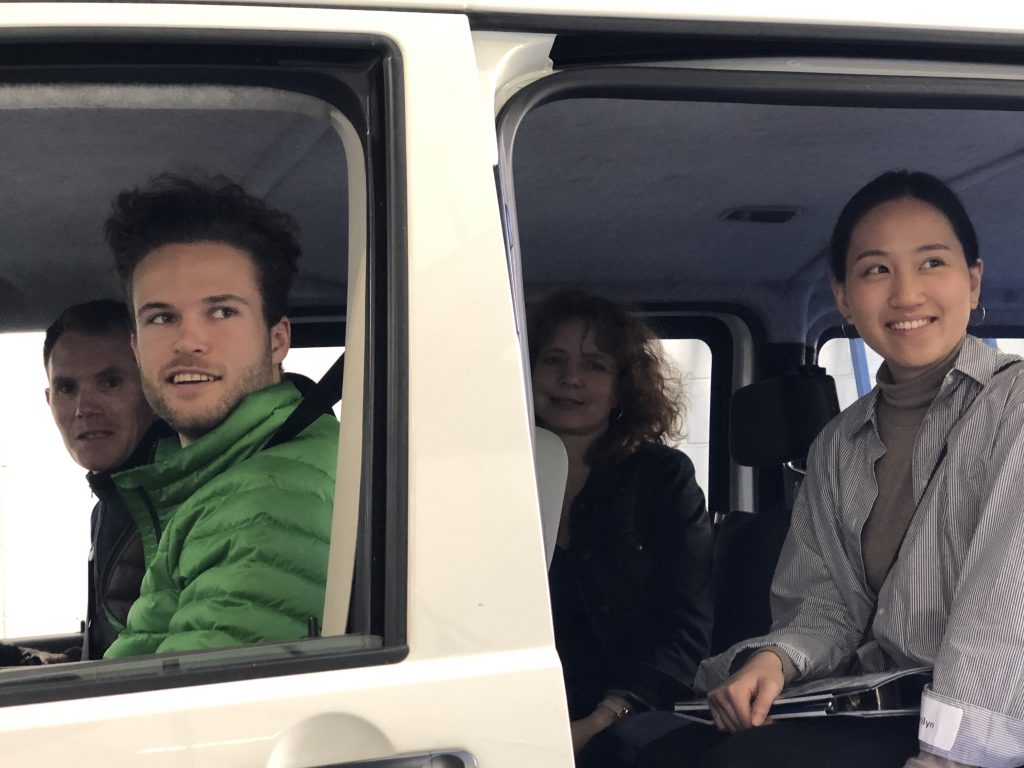 Four people in the Total Ability van looking out the left side with the door van open and smiling