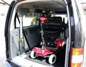 SG50 hoist with red scooter in boot of van