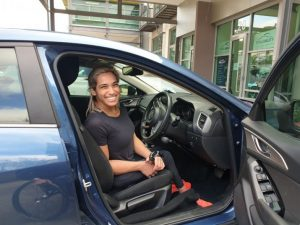 Madi De Rozario in driver seat with satellite accelerator from total Ability